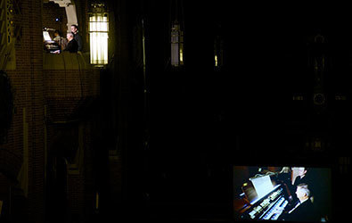 Craig Cramer's live performance showing his image projected on a large screen in the nave of Our Lady of Refuge so the audience can see him play